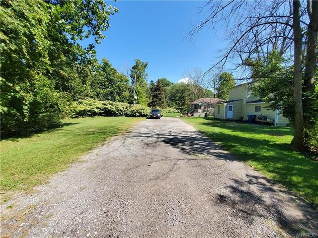 Road view featured at 9705 Pearl St, Angola, NY 14006