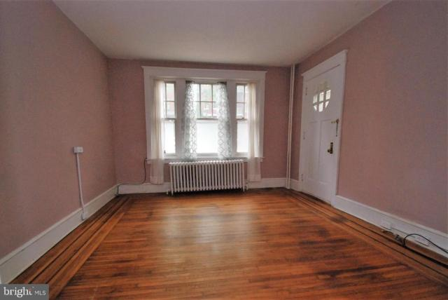 Living room featured at 165 N Hanover St, Pottstown, PA 19464