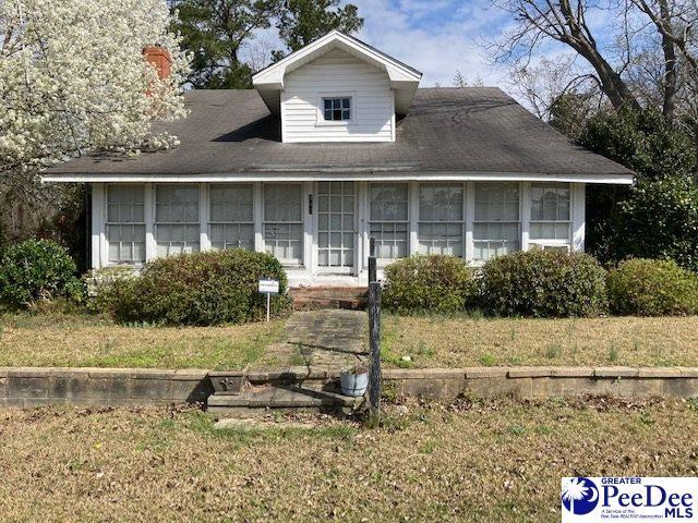 Porch yard featured at 307 E 1st Ave, Lake View, SC 29563