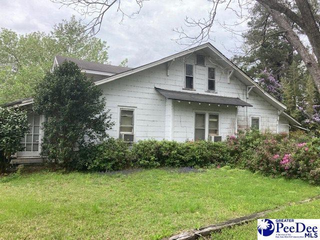 Yard featured at 307 E 1st Ave, Lake View, SC 29563