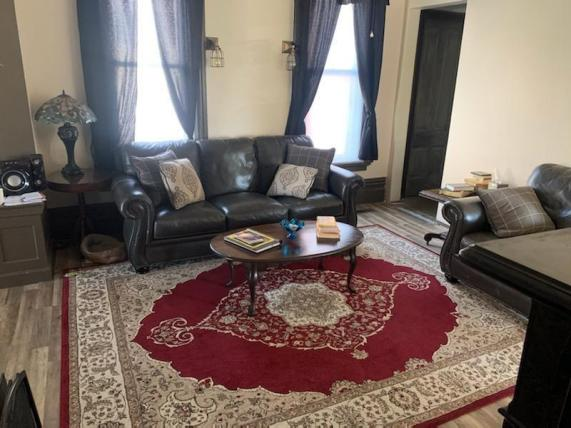 Living room featured at 400 N Walnut St, Bay City, MI 48706