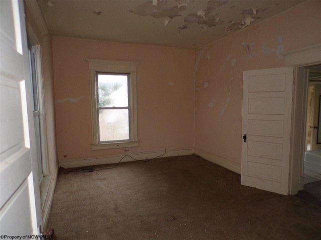 Bedroom featured at 305 Clark St, Clarksburg, WV 26301