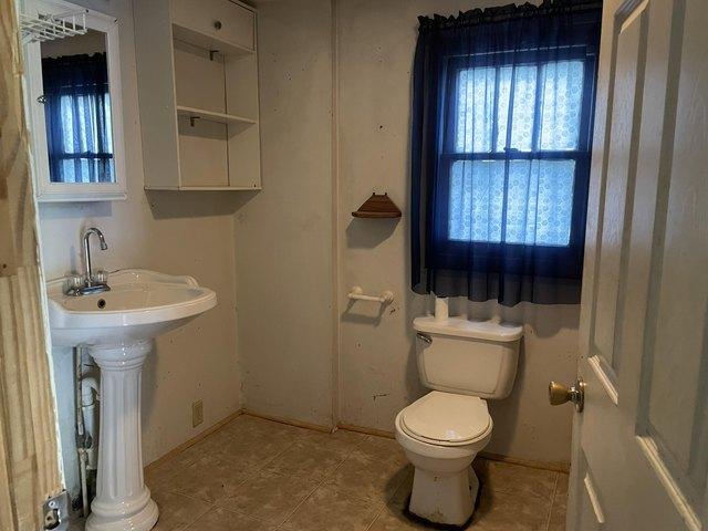 Bathroom featured at 3832 Flat St, Big Stone Gap, VA 24219