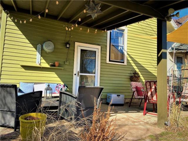 Porch yard featured at 2443 Willow Ave, Niagara Falls, NY 14305