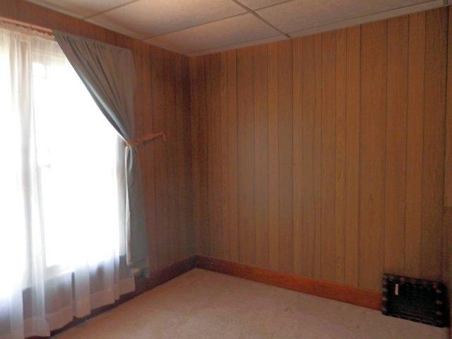 Bedroom featured at 129 N Locust St, Osborne, KS 67473