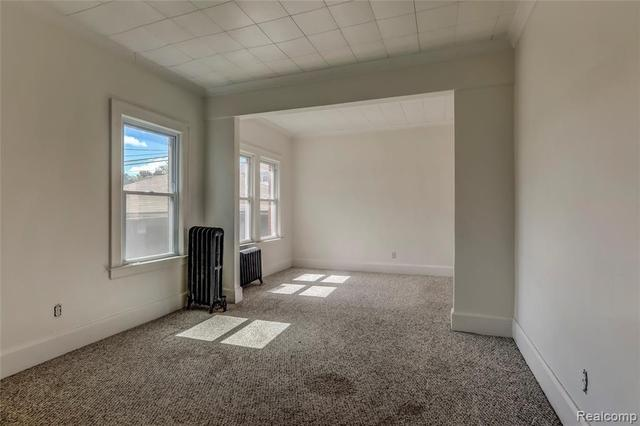 Bedroom featured at 52 Elm St, River Rouge, MI 48218