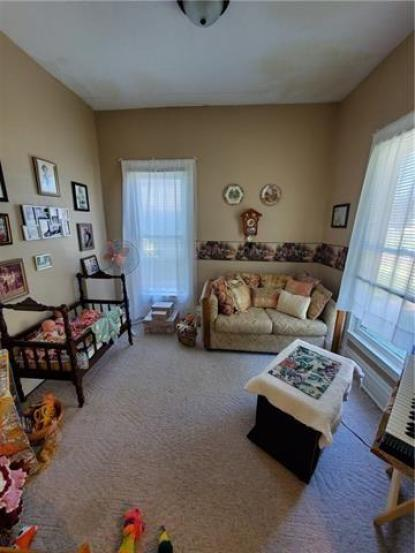 Living room featured at 217 W State St, Troy, KS 66087