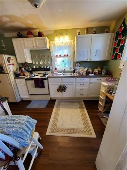 Laundry room featured at 217 W State St, Troy, KS 66087