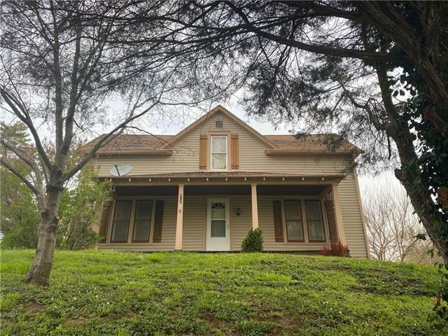 Porch featured at 403 W Pine St, Oregon, MO 64473
