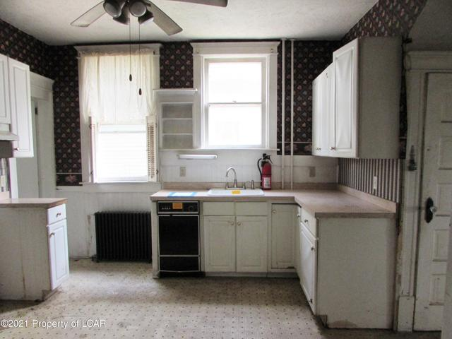 Kitchen featured at 329 E Main St, Plymouth, PA 18651