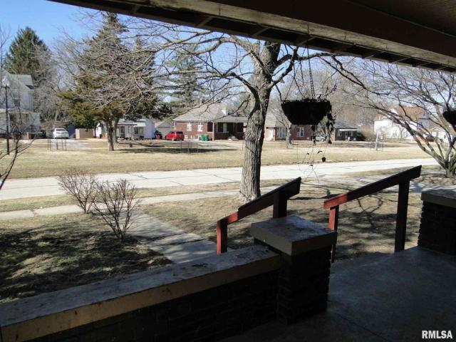 Porch yard featured at 113 Chandler Blvd, Macomb, IL 61455