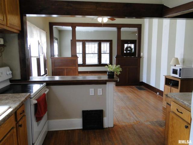Kitchen featured at 113 Chandler Blvd, Macomb, IL 61455