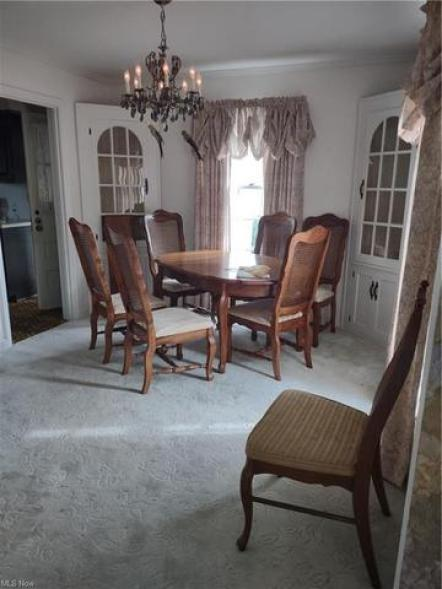 Dining room featured at 27 W 4th St, Newton Falls, OH 44444