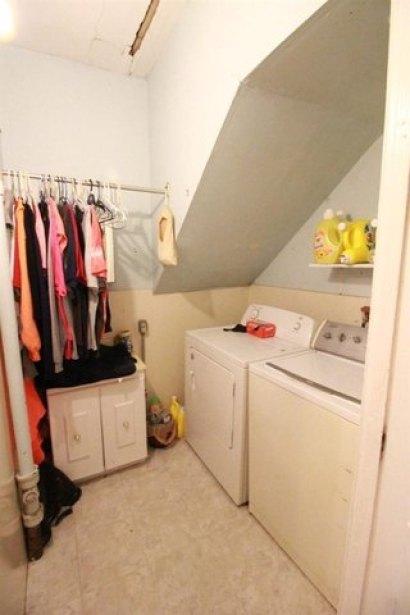 Laundry room featured at 217 NE 4th St, Abilene, KS 67410