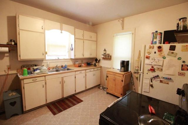 Kitchen featured at 217 NE 4th St, Abilene, KS 67410