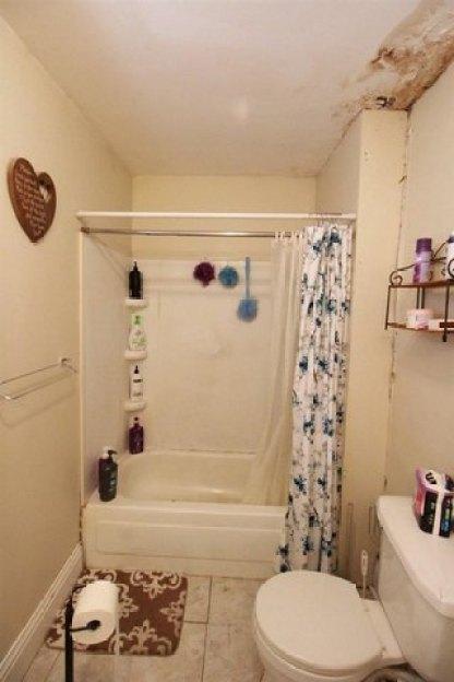 Bathroom featured at 217 NE 4th St, Abilene, KS 67410