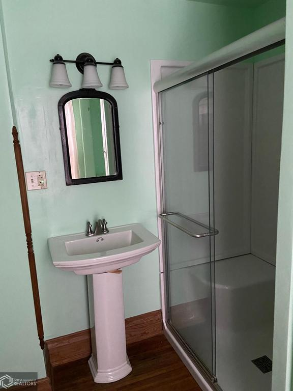 Bathroom featured at 407 E Maple St, Red Oak, IA 51566