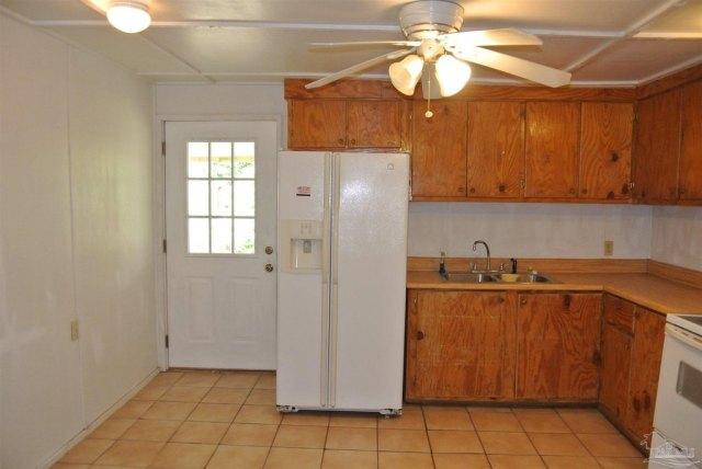 Kitchen featured at 5714 Sunbeam St, Milton, FL 32570