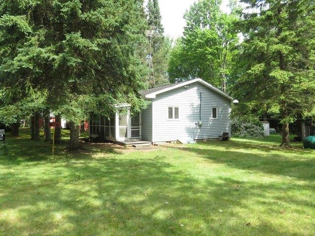 Yard featured at 945 Margaret Lake Rd, Three Lakes, WI 54562