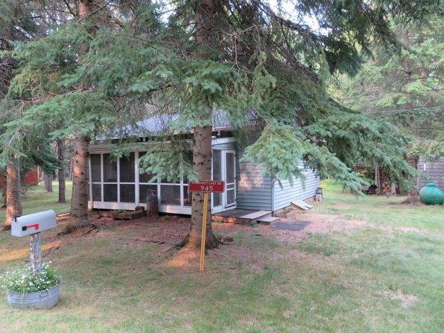 Porch yard featured at 945 Margaret Lake Rd, Three Lakes, WI 54562