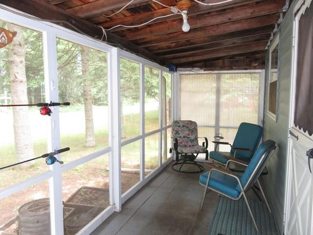 Porch featured at 945 Margaret Lake Rd, Three Lakes, WI 54562