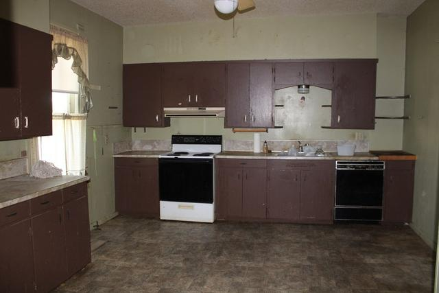 Kitchen featured at 208 N 11th St, Ballinger, TX 76821