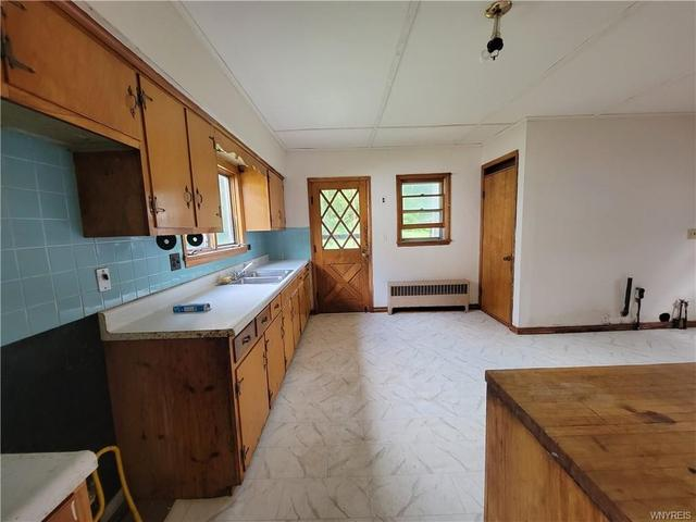 Kitchen featured at 24 Stevens Ave, Friendship, NY 14739