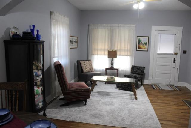 Living room featured at 1112 Broadway St, Larned, KS 67550