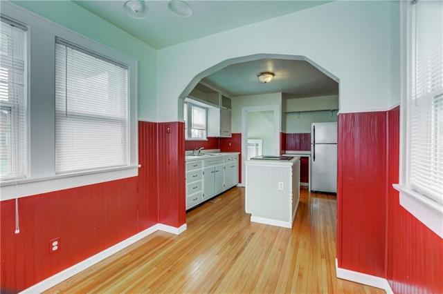 Laundry room featured at 709 S 22nd St, Decatur, IL 62521