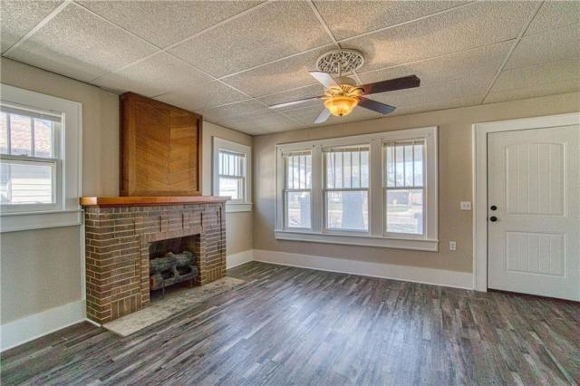 Living room featured at 209 N Louis Tittle Ave, Mangum, OK 73554