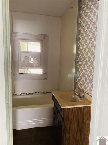 Bathroom featured at 211 W Elm St, Marion, KY 42064