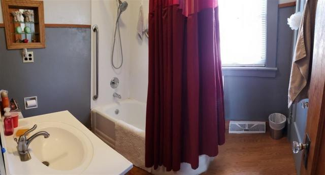 Bathroom featured at 321 E 1st St, Bison, KS 67520