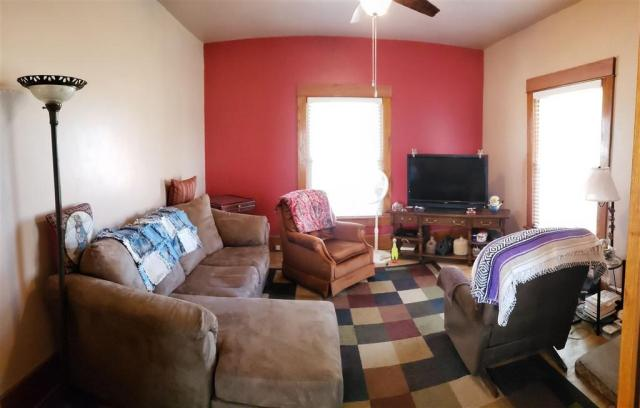 Living room featured at 321 E 1st St, Bison, KS 67520