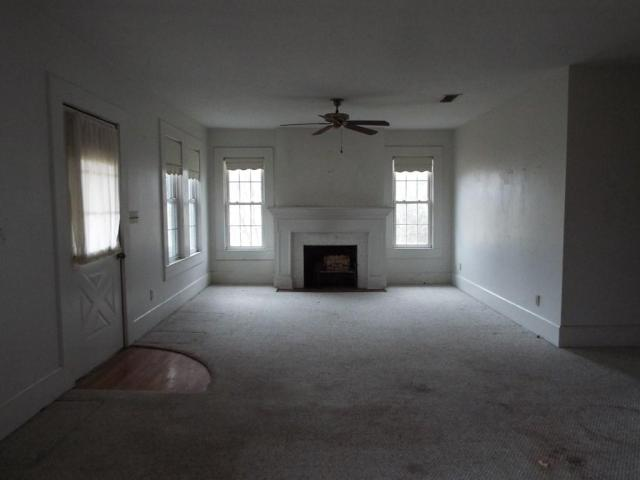 Living room featured at 719 College St, Tylertown, MS 39667