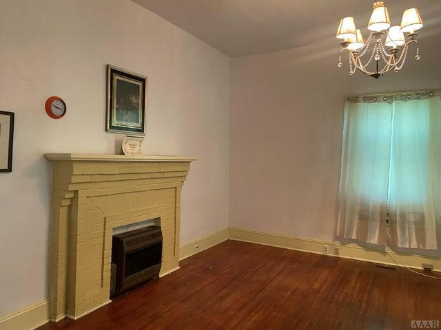 Living room featured at 408 S Main St, Rich Square, NC 27869