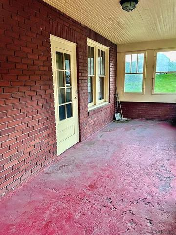 Porch featured at 254 Locust St, Windber, PA 15963