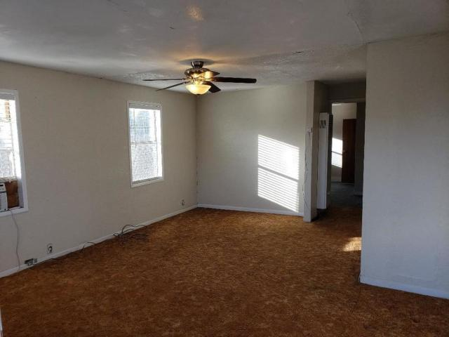 Bedroom featured at 1011 W Walnut St, Roswell, NM 88203