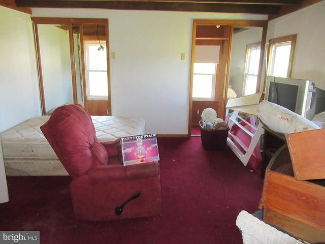 Living room featured at 26692 Old State Rd, Crisfield, MD 21817