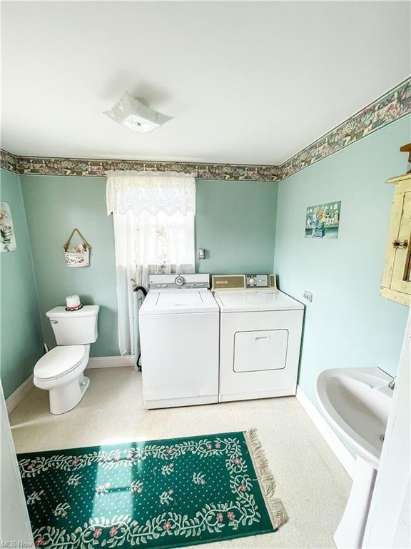 Laundry room featured at 874 W Main St, Adena, OH 43901