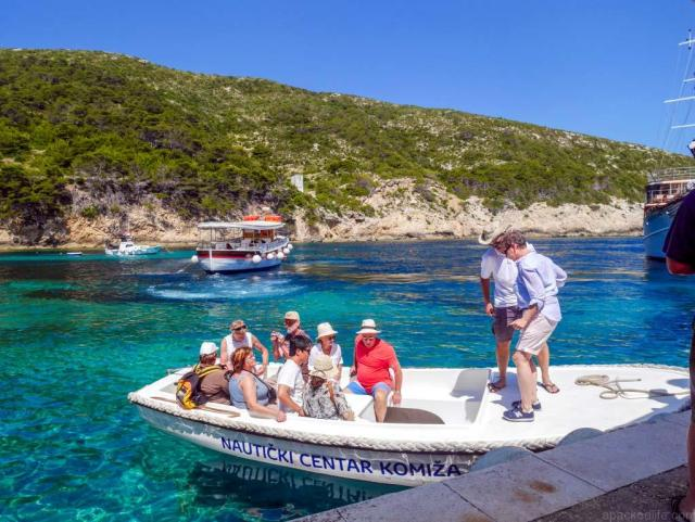 LaughTravelEat blue cave tourist boat vis near split croatia - Best Boat Trips apackedlife.com