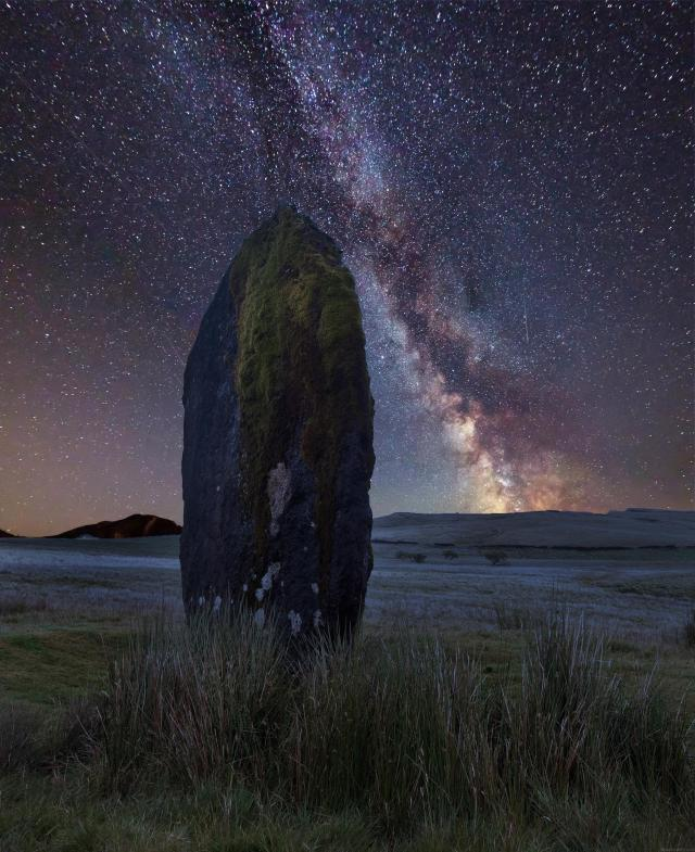 Stargazing UK - Where To See The Best Night Skies - Vibrant Milky Way composite image over landscape of Ancient prehistoric stones