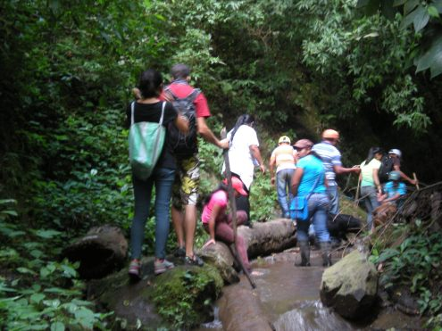 hiking to the waterfall with the host family members