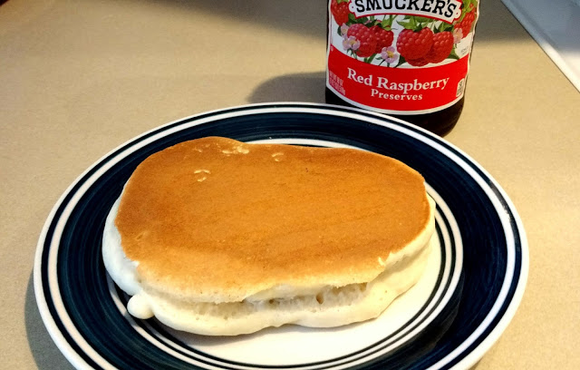 It looks like a normal pancake, but its center is full of raspberry-y goodness.