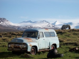 Old car with horse and glacier