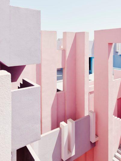 La Muralla Roja modern Spanish architecture designed by Ricardo Bofil. Pastel pink colourful building..