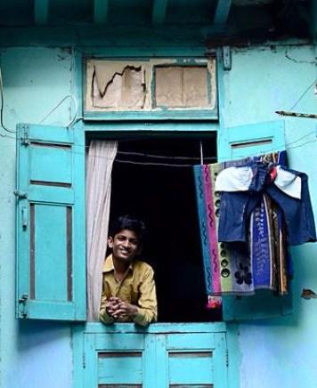 asian boy in window