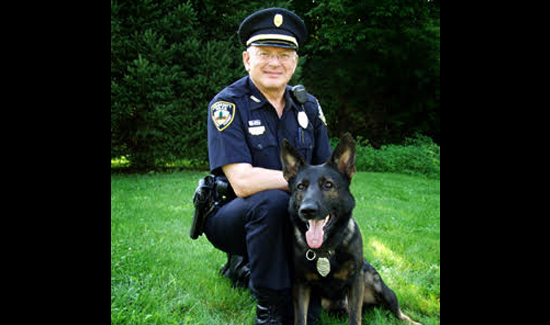 Chris Morrell with his beloved K-9 rescue dog.