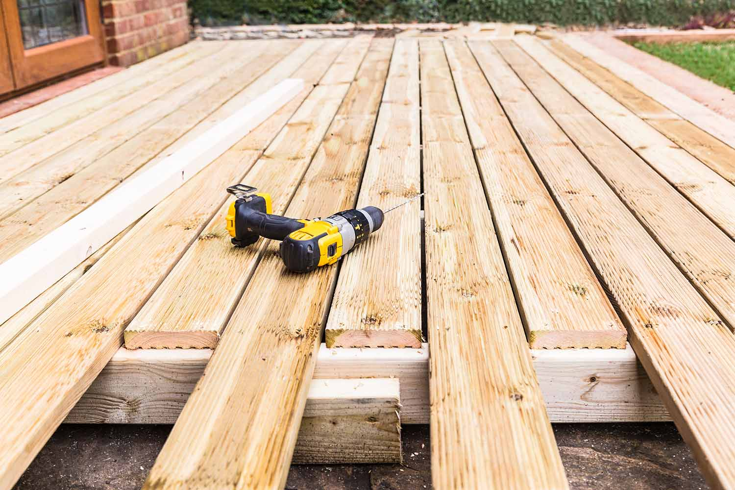 is it cheaper to build a deck or patio
