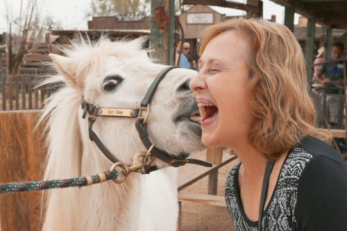 Trick pony Earl Gray surprises a guest with a big kiss. (Courtesy of Dennis Liddell.)