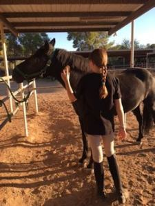 Cactus Shadows Student Ashleigh with Horse.
